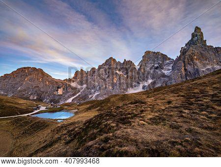 Evening Twilight Autumn Alpine Dolomites Mountain Scene, Trento, Italy. Lake Or Laghetto Baita Segan