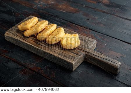 Homemade Chicken Nuggets Fried On Dark Wooden Background, With Space For Text.
