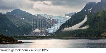 Lake Svartisvatnet And Cloudy View To Svartisen Glacier (meloy, Norway). Panorama.