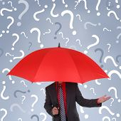 Businessman holding red umbrella with question mark rain concept for confusion, decisions or business recruitment poster