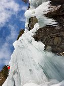 Ice climbing a wall of ice in South Tyrol Italy. poster