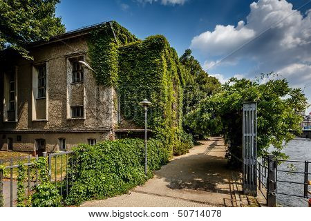 River Spree Embankment And House With Grape Vines, Berlin, Germany