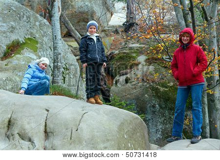 Lofty Stones In Autumn Forest And Family