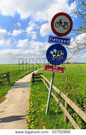 Do not disturb catle sign along a bike trail in Holland poster