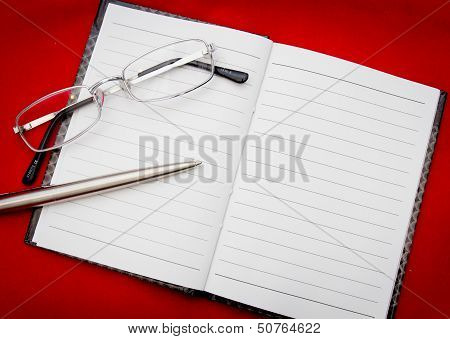Reading Glasses On Notepad