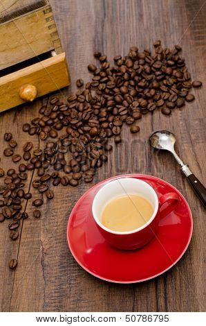 Espresso Coffe In Red Cup With Arabica Beans