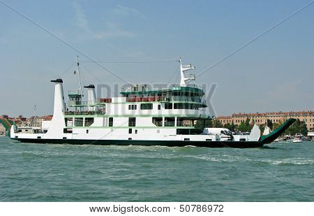 giant ferryboat for the transport of people and cars in the lagoon of Venice in Italy poster