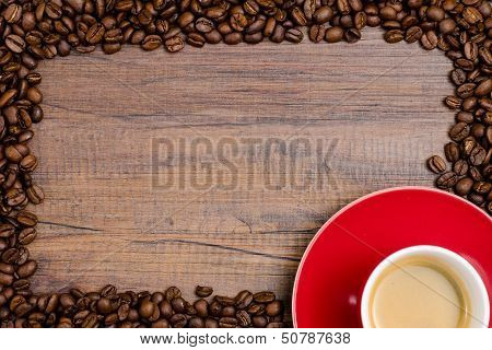 Coffee Beans As Frame With Red Mug