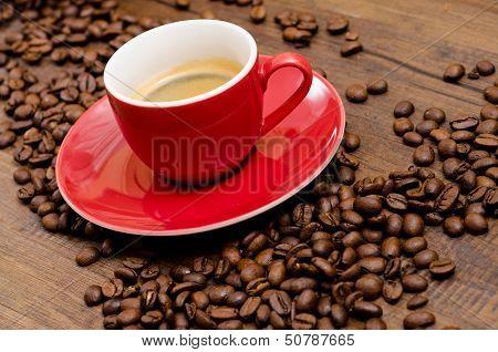Arabica Coffee Beans And Red Espresso Mug