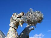 Impressive fire-breathing dragon sculpture made entirely of recycled materials Jardin des Plantes Paris France poster