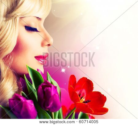 Beauty Woman with Spring Flower bouquet. Cheerful girl with a Bouquet of Tulip flowers. Isolated on a white background. Happy surprised model woman smelling flowers. Mothers Day