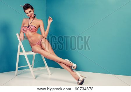 Beauty Pinup Girl In A Sailor Swimsuit