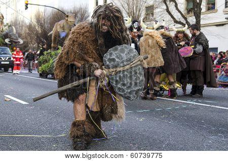 Man dressed Neanderthal in carnival
