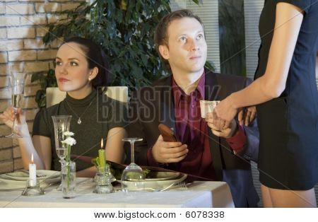 Man Paying Bill In Restaurant