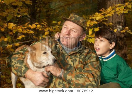 Grandfather, Grandson And Dog