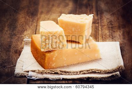 Italian  Parmesan Cheese On Wooden Background Close Up. Piece Of Parmigiano  Cheese On A Napkin, Rus