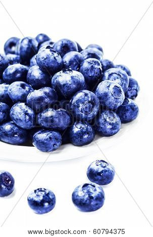 Fresh Blueberries On White Plate Isolated On White Background Close Up. Group Of Huge Blue Berries M