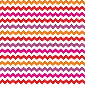 Aztec Chevron seamless colorful vector pattern or background with zig zag red, purple, pink and orange stripes on white background. Thanksgiving background, desktop wallpaper or website design element poster