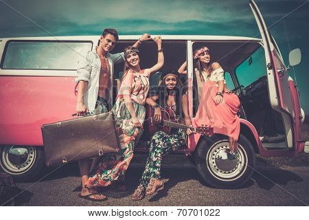 Multi-ethnic hippie friends with guitar on a road trip poster