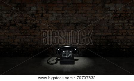 Old black telephone on brick wall