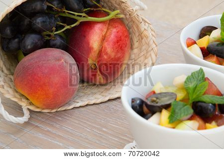 Woven Basket With Peaches And Grapes