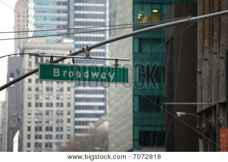 Broadway Sign In Manhattan, New York, In Front Of Buildings
