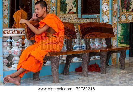 Monk making phone call