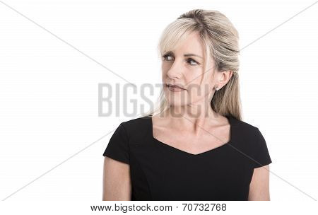 Skeptical Face Of A Elderly Attractive Blond Businesswoman.