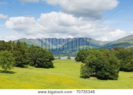 Country scene of Langdale Valley and Fairfield Horse mountains from Wray Castle The Lakes UK