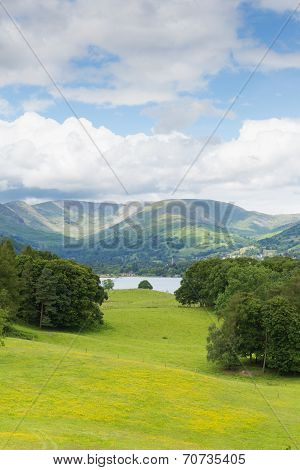 Country scene of Langdale Valley and Fairfield Horse mountains from Wray Castle Lake District