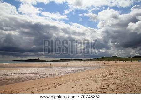 Dunstanburgh Castle with stormy skies Taken from Embleton poster