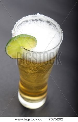 Glass Of Beer With Slice Of Lemon.