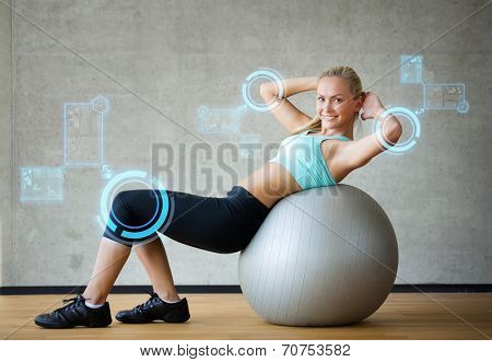 fitness, sport, training, future technology and lifestyle concept - smiling woman with exercise ball in gym over virtual screen projections poster