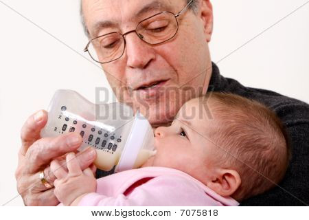 Grandpa Bottle Feeding Baby Girl