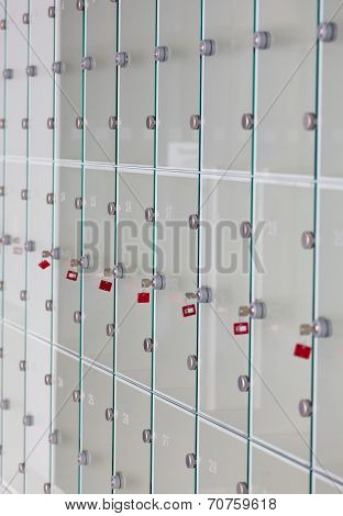 Cells in a left-luggage office with keys