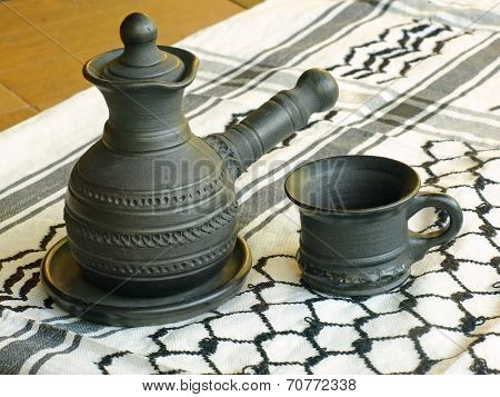 Ceramic Coffeepot And Cup On A White Keffiyah Scarf.