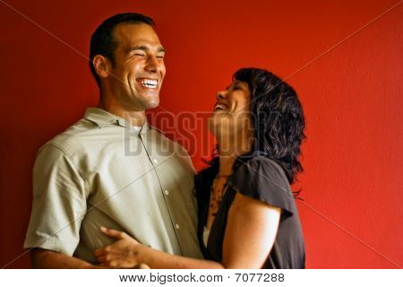 Young Adult Couple Laughing and Smiling