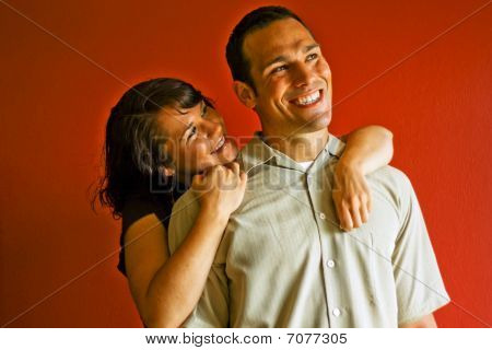 Young Attractive Adult Couple Relationship Hugging Smiling