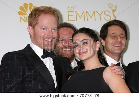 LOS ANGELES - AUG 25:  Jesse Tyler Ferguson, Ariel Winter at the 2014 Primetime Emmy Awards - Press Room at Nokia Theater at LA Live on August 25, 2014 in Los Angeles, CA