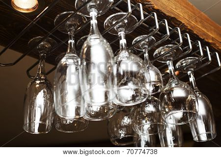 glasses suspended from above the bar