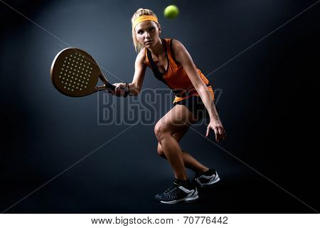 Beautiful Woman Playing Padel Indoor. Isolated On Black.