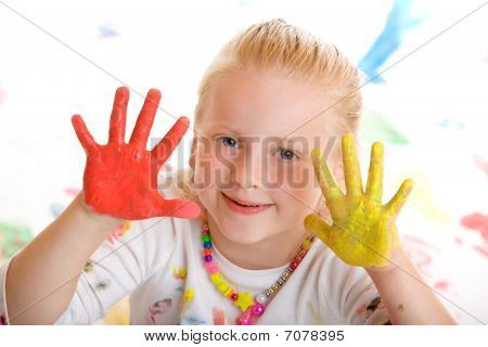 Young Happy Smiling Child Draws With Colourful Finger Paint