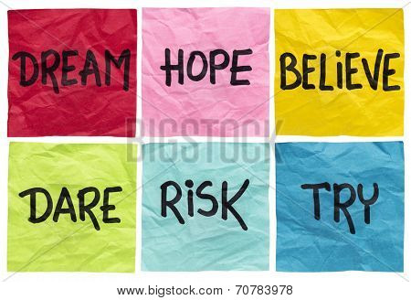 dream, hope, believe, dare, risk, try - motivational concept - a set of isolated crumpled sticky notes with handwritten advice and reminders poster