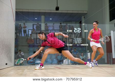 AUGUST 19, 2014 - KUALA LUMPUR, MALAYSIA: Camille Serme of France (shirt skirt) plays Habiba Ahmed of Egypt (black skirt) in a match in the CIMB Malaysian Open Squash Championship 2014.
