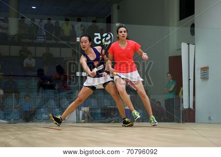 AUGUST 19, 2014 - KUALA LUMPUR, MALAYSIA: Low Wee Wern of Malaysia (blue) hits a return in her match against Heba El Torky of Egypt in the CIMB Malaysian Open Squash Championship 2014.