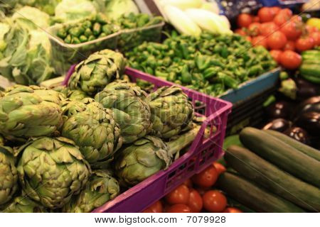 Artichoke Chillies And Cucumber On Market Stand