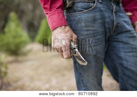 weathered farmer's hands holding pruning shears