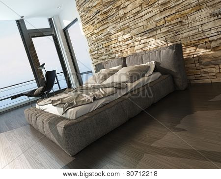 3D Rendering of Modern stylish upholstered king size bed in shades of brown in a sunny bedroom with a feature rough stone wall and panoramic floor-to-ceiling windows with a balcony