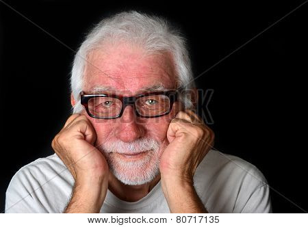 A good looking senior man with a friendly smile on his face looking directly into the camera