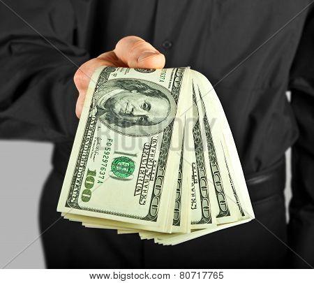 Man Holding Money In Hands